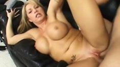 Curvy blonde exposes her amazing body and gets fucked hard on the sofa