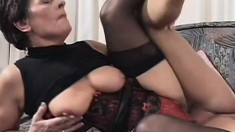 Short haired mature lady with big boobs gets pounded by a young stud