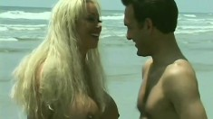 Huge Breasted Cougar Seduces A Guy And Fucks His Big Cock On The Beach