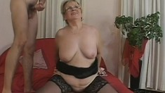 Lusty grandma gets spit roasted by two horny young stallions