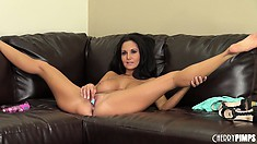 Ava plays with her big tits and sticks her bottoms in her pussy