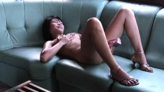 Beautiful Asian chick gets fully naked and satisfies her aching pussy