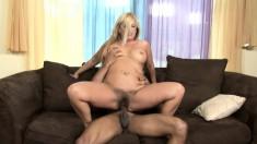 Buxom blonde Joclyn Stone finds it hard to resist a huge black stick