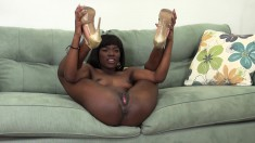 Ebony Ana Foxxx shows it all and sucks and screws a white dick