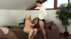 Buxom blonde granny takes a young man's big cock in her hairy snatch