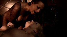 Sexy blonde gets tied up and spanked by a tight-bodied ebony babe