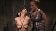 Naughty brunette gets her tight cunt worked by a wild dominatrix