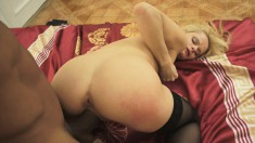 Petite blonde puts on her best lingerie and enjoys a big black stick