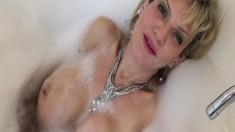 Mature busty blonde gives a bubble bath masturbation tutorial