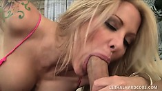 Helly Hellfire lets her tits out while blowing a hung stranger