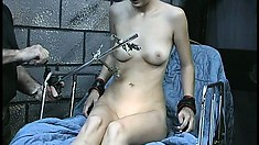 Slutty slave Tawny gets her nips clipped and her cunt drilled