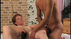 Nasty old lady, Jana, gets a deep boning from a long dildo and sucks dick