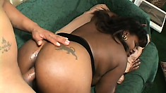 The caramel hottie sighs with delight as the black guy fucks her ass all over the couch