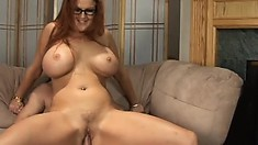 Stacked redhead cougar Kitti Lynxxx gets on top and wildly rides that stiff cock