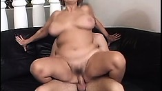 Granny gets her pussy pumped full by a hard dick on the couch