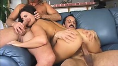 Cock-hungry squirter seduces two guys and gets them to spit roast her