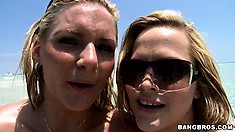Ass and titty battles are what these two sluts love on the beach