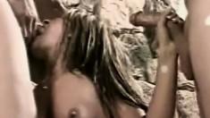 Lustful babe Rio Mariah has two hard dicks banging her holes at once