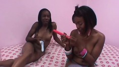 Young ebony lesbians lick each other's cunts and have fun with sex toys
