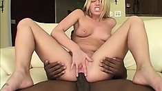 Slutty blonde with sexy tits welcomes a huge black cock deep in her fiery anal hole