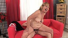 Chubby mature woman with sagging tits has her cheeks beaten by big daddy