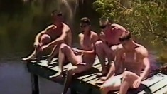 Four young studs feed their desire for masturbation at the lake