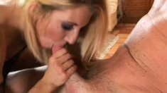 Appealing bitch in impressive sexy outfit works nice cock with her hands and mouth