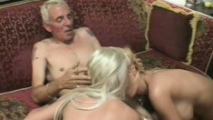 Two wonderful blondes please each other's fiery twats and share an older guy's cock
