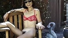 Mature Asian freak takes her panties off to expose her wild bush