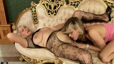 Alluring young girls engaging in lesbian sex with horny mature ladies
