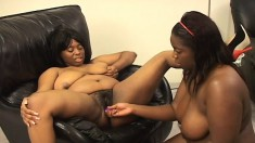 Two curvaceous black lesbians relinquish their pussies to one another