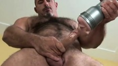 Hunky bear with a muscled body pleases his big cock with a fleshjack
