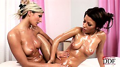 This oily lesbian sex massage session is impossible to leave unnoticed