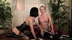 Two cute lesbians are having a great time playing with their toys