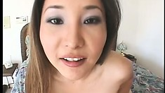 Naughty ebony girl and her lovely Asian friend share a thick cock