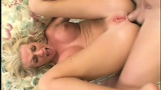 Two well-endowed bucks have their way with a saucy blonde chick