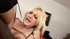 Tarty blonde in mesh lingerie gets rocked by two huge black guys