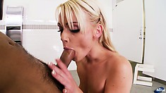 Blonde In A Restroom Gets On Her Knees To Suck On That Gulley Raker
