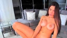 Queensex is a busty slut toying her twat on webcam