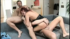 Beautiful redhead Claudia Adams has two horny studs pounding her holes