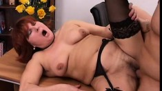 Horny mature lady in black stockings getting fucked hard in the office