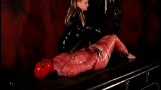 Latex fetish mistress loves to dish out some punishment on her slave