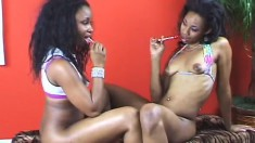 Black beauties Gen and Jasmine drive each other's pussies to pleasure