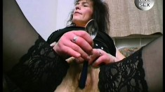 A nasty older woman opens up her loose holes with some huge objects